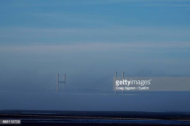 severn bridge over seascape against blue sky - heavens gate cult stock pictures, royalty-free photos & images