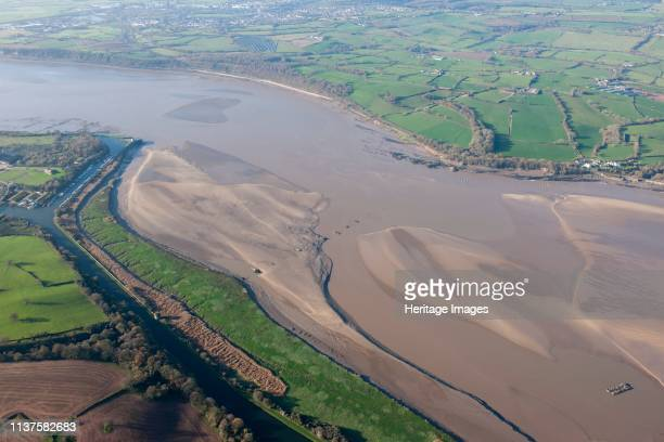Severn Estuary, Gloucestershire, 2014. Aerial view showing the foundations of the Severn Railway Bridge and the wrecks of the two tanker barges...