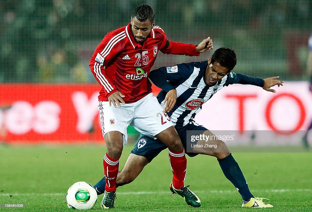 Severo Meza (R) of Monterrey challenges Hossam Ashour of Al-Ahly SC during the FIFA Club World Cup 3rd Place Match between Al-Ahly SC and CF Monterrey at International Stadium Yokohama on December 16, 2012 in Yokohama, Japan.
