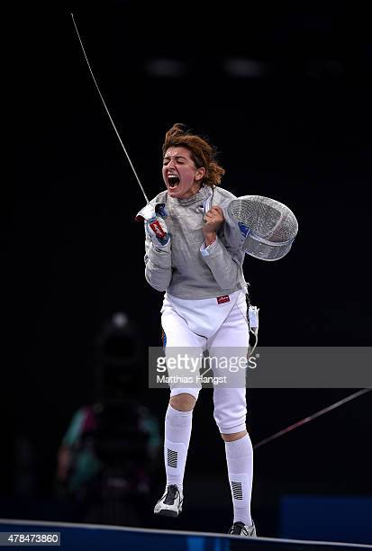 Sevil Bunyatova of Azerbaijan celebrates victory over Margaux Rifkiss of France in the Women's Individual Sabre Semi Final during day thirteen of the...
