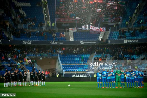 Sevilla and Malaga players observe a minute of silence for former Spanish footbal star Enrique Castro Quini who died on February 27 before the...