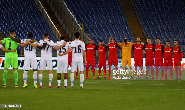Sevilla and SS Lazio players stand for a minute of silence for the death of Emiliano Sala during the UEFA Europa League Round of 32 first leg match...