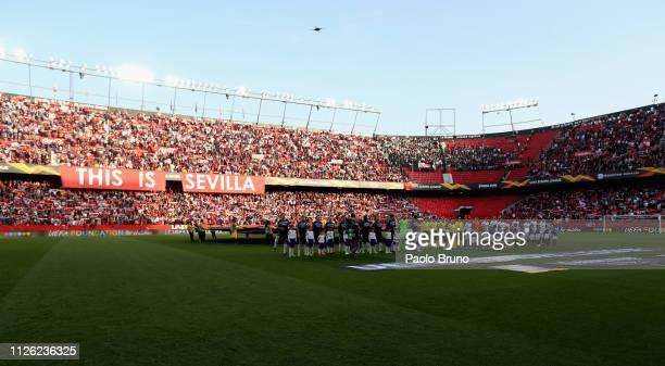 Sevilla and SS Lazio players stand prior the UEFA Europa League Round of 32 Second Leg match between Sevilla v SS Lazio at Estadio Ramon Sanchez...