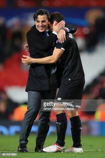Sevilla coach Vincenzo Montella celebrates victory with Wissam Ben Yedder of Sevilla during the UEFA Champions League Round of 16 Second Leg match...