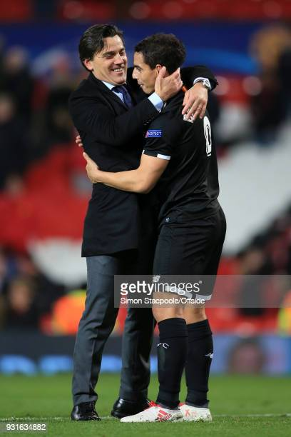 Sevilla coach Vincenzo Montella celebrates victory with Wissam Ben Yedder of Sevilla after the UEFA Champions League Round of 16 Second Leg match...