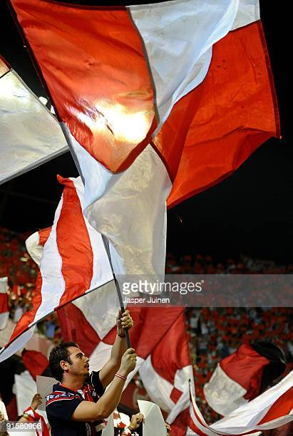 Sevilla fan waves a huge flag as the players enter the pitch at the start of the La Liga match between Sevilla and Real Madrid at the Estadio Ramon...