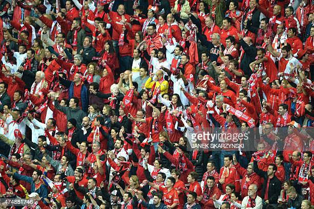Sevilla fans cheer during the UEFA Europa League final football match between FC Dnipro Dnipropetrovsk and Sevilla FC at the Narodowy stadium in...