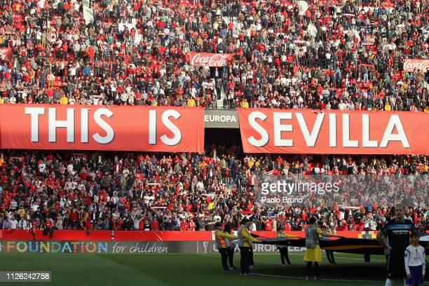 Sevilla fans cheer for their team during the UEFA Europa League Round of 32 Second Leg match between Sevilla v SS Lazio at Estadio Ramon Sanchez...