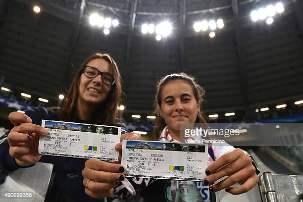 Sevilla fans show ticket prior to the UEFA Champions League group E match between Juventus and Sevilla FC on September 30 2015 in Turin Italy