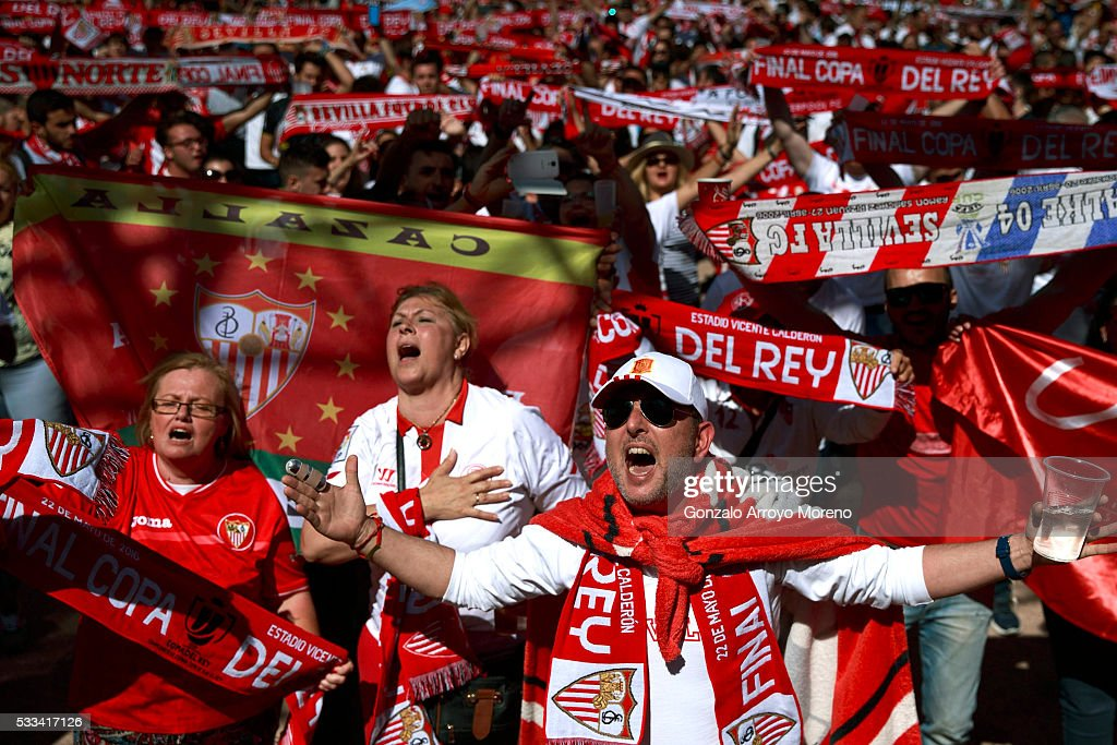 Sevilla FC fans sing their hymn before the Copa del Rey Final match between FC Barcelona and Sevilla FC at the Sevilla fan zone placed close to Vicente Calderon Stadium on May 22, 2016 in Madrid, Spain.