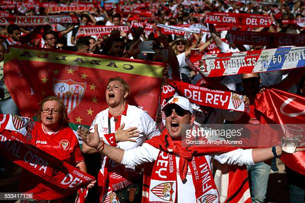 Sevilla FC fans sing their hymn before the Copa del Rey Final match between FC Barcelona and Sevilla FC at the Sevilla fan zone placed close to...