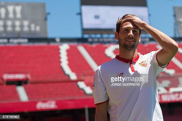 Sevilla FC football team's new player Argentineborn Italian midfielder Franco Vazquez poses on the pitch during his official presentation at the...