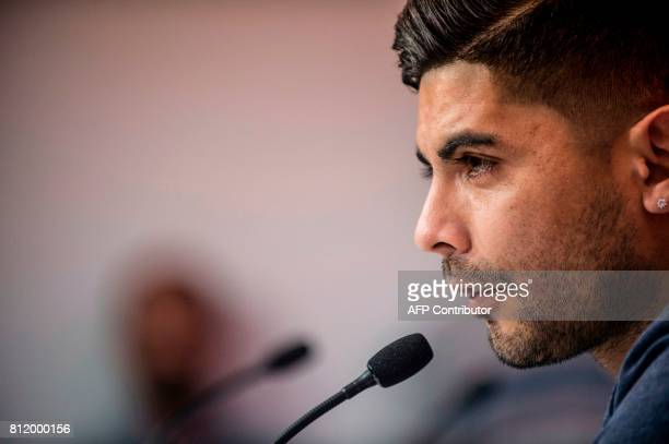 Sevilla FC football team's new player Argentinian midfielder Ever Banega speaks during a press conference following his official presentation at the...