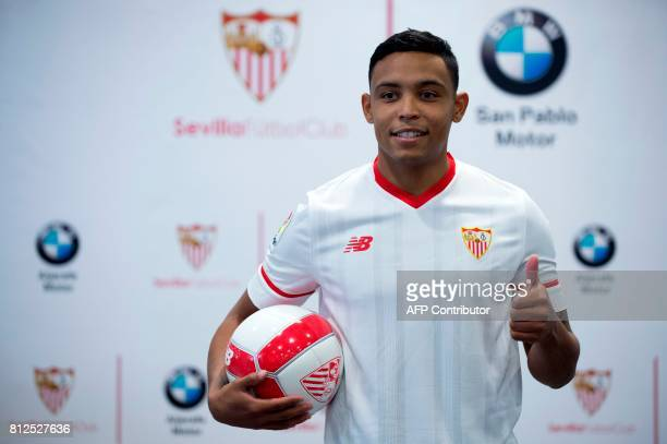 Sevilla FC football team's new player Colombian forward Luis Fernando Muriel gives the thumbs up during his official presentation in Sevilla on July...