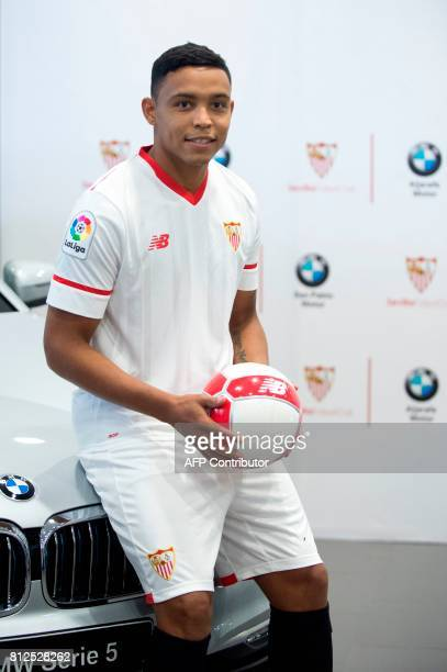 Sevilla FC football team's new player Colombian forward Luis Fernando Muriel poses during his official presentation in Sevilla on July 11 2017 / AFP...
