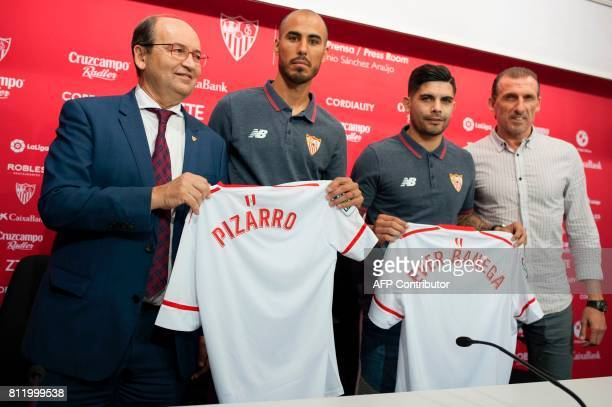 Sevilla FC football team's new players, Argentinian midfielder Guido Pizarro and Argentinian midfielder Ever Banega pose with their new jersey...