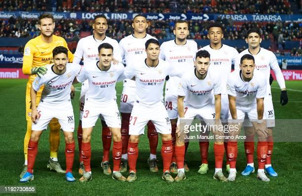 Sevilla FC line up for a team photo prior to the Liga match between CA Osasuna and Sevilla FC at El Sadar Stadium on December 08 2019 in Pamplona...