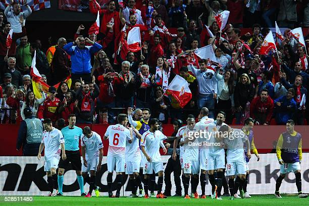 Sevilla FC players celebrate after Mariano Ferreria of Sevilla FC scored his team's third goal during the UEFA Europa League Semi Final second leg...
