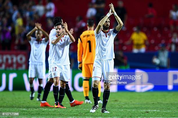 Sevilla FC players celebrate defeating Olympique Lyonnais at the end of the UEFA Champions League Group H match between Sevilla FC and Olympique...