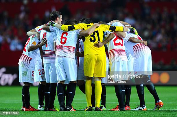Sevilla FC players hug each others during the UEFA Europa League Semi Final second leg match between Sevilla and Shakhtar Donetsk at Estadio Ramon...