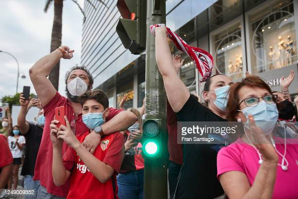 Sevilla FC supporters cheer prior to the La Liga match between Sevilla FC and Real Betis on June 11, 2020 in Seville, Spain. Spain's La Liga is...