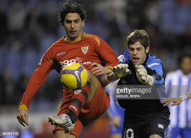 Sevilla FC´s french Julien Escude touches the ball next to Deporivo Coruna´s goalkeeper Fabricio Agosto during their King's Cup 2nd league football...
