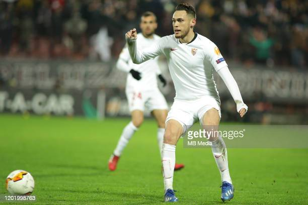 Sevilla FC's Lucas Ocampos looks at the ball during the UEFA Europa League round of 32 first leg match between CFR Cluj and Sevilla FC at...