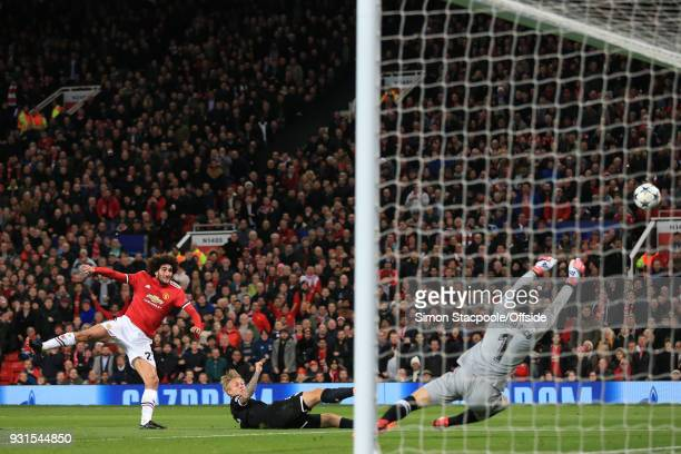 Sevilla goalkeeper Sergio Rico saves an effort from Marouane Fellaini of Man Utd during the UEFA Champions League Round of 16 Second Leg match...