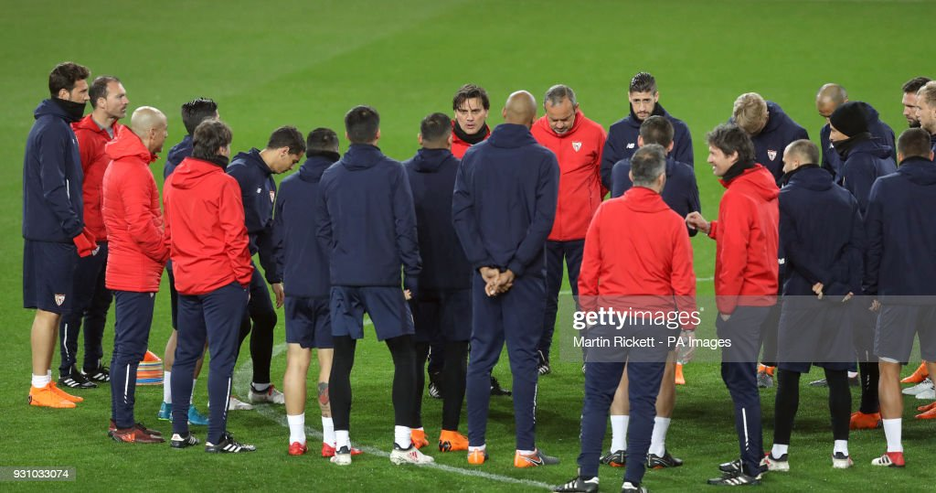 Sevilla head coach Vincenzo Montella (centre) speaks to his players during the training session at Old Trafford, Manchester.