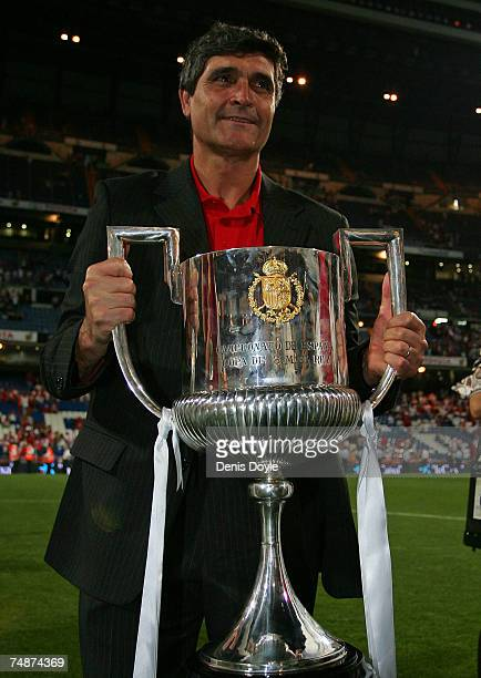 Sevilla manager Juande Ramos celebrates with the Copa del Rey trophy after Sevilla beat Getafe 10 in the Copa del Rey final at the Santiago Bernabeu...