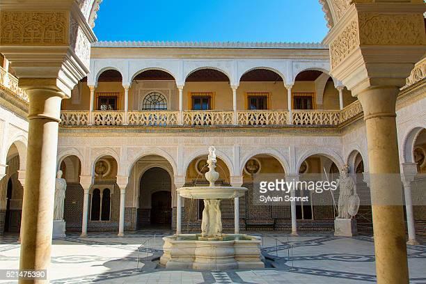 sevilla, patio in casa de pilatos - seville stock pictures, royalty-free photos & images