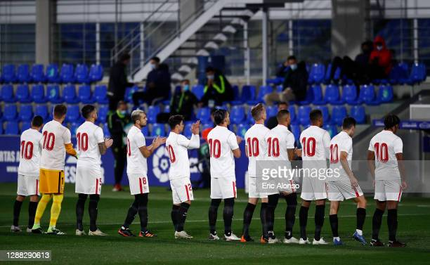 Sevilla players all wear shirts with the number ten in memory of Diego Maradona prior to the La Liga Santander match between SD Huesca and Sevilla FC...