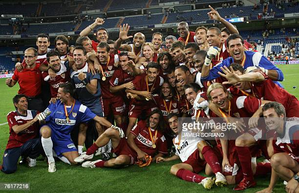 Sevilla players celebrate after beating to Real Madrid during Spain's Supercup second leg football match at Santiago Bernabeu stadium in Madrid 19...