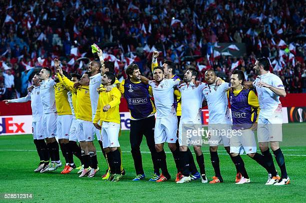 Sevilla players celebrate after defeating Shakhtar Donetsk during the UEFA Europa League Semi Final second leg match between Sevilla and Shakhtar...