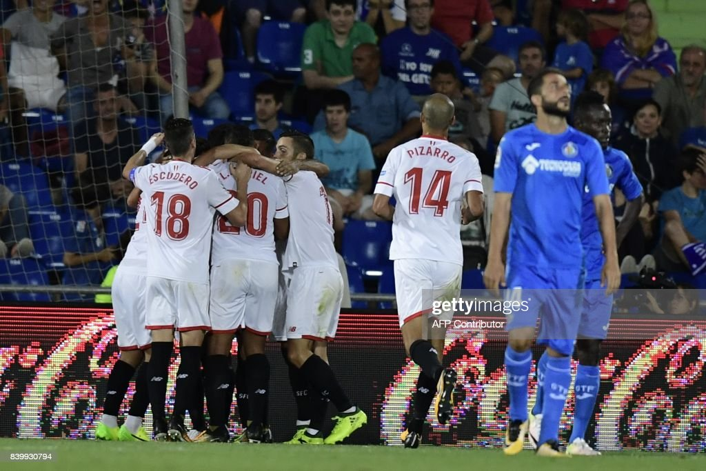 Sevilla players celebrate after scoring during the Spanish league football match Getafe CF vs Sevilla FC at the Coliseum Alfonso Perez stadium in Getafe on August 27, 2017. /