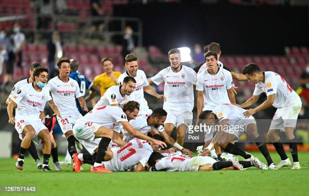 Sevilla players celebrate on the final whistle following their team's victory in the UEFA Europa League Final between Seville and FC Internazionale...