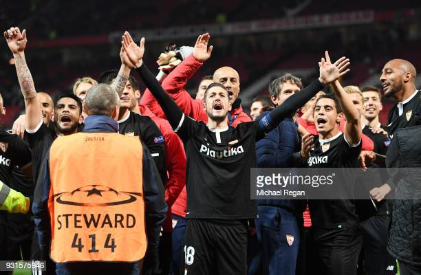 Sevilla players celebrate victory after the UEFA Champions League Round of 16 Second Leg match between Manchester United and Sevilla FC at Old...