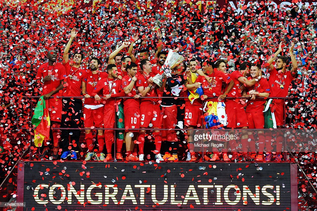 Sevilla players celebrate victory with the trophy after the UEFA Europa League Final match between FC Dnipro Dnipropetrovsk and FC Sevilla on May 27, 2015 in Warsaw, Poland.