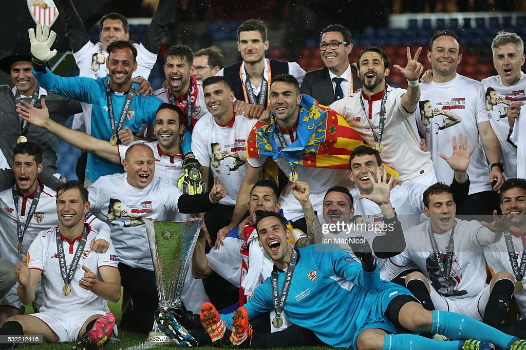 Sevilla players celebrate with the trophy during the UEFA Europa League Final match between Liverpool and Sevilla at St. Jakob-Park on May 18, 2016 in Basel, Switzerland .