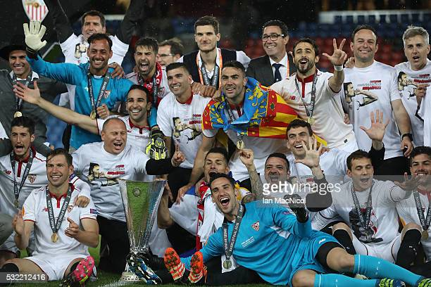 Sevilla players celebrate with the trophy during the UEFA Europa League Final match between Liverpool and Sevilla at St JakobPark on May 18 2016 in...