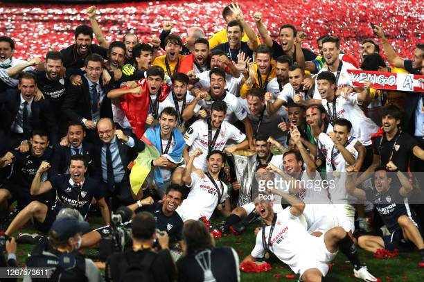 Sevilla players celebrate with the UEFA Europa League Trophy following their team's victory in the UEFA Europa League Final between Seville and FC...