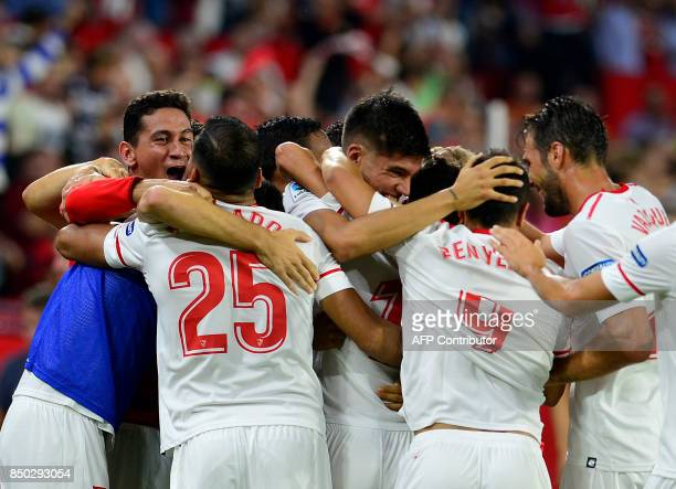 Sevilla players celebtrate a goal during the Spanish league football match Sevilla FC against UD Las Palmas at the Ramon Sanchez Pizjuan stadium in...