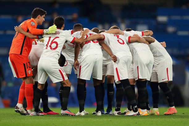 Sevilla players huddle before the UEFA Champions League Group E stage match between Chelsea FC and FC Sevilla at Stamford Bridge on October 20, 2020...