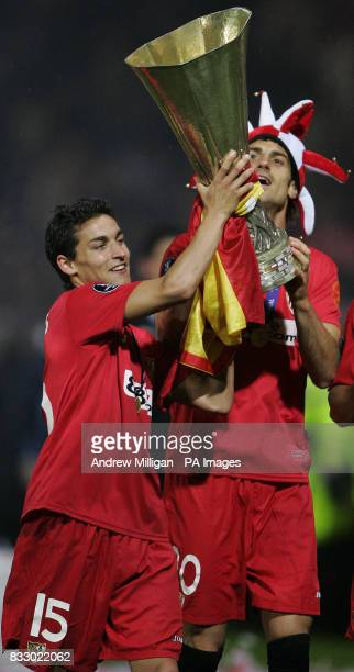 Sevilla players Jesus Navas and Aitor Ocio celebrate winning the Uefa cup