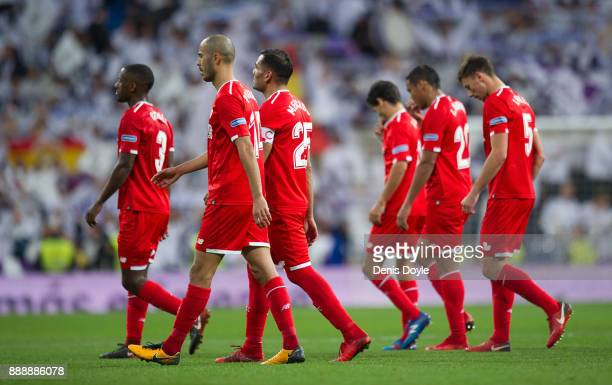 Sevilla players leave the pitch after losing 50 to Real Madrid during the La Liga match between Real Madrid and Sevilla at Estadio Santiago Bernabeu...