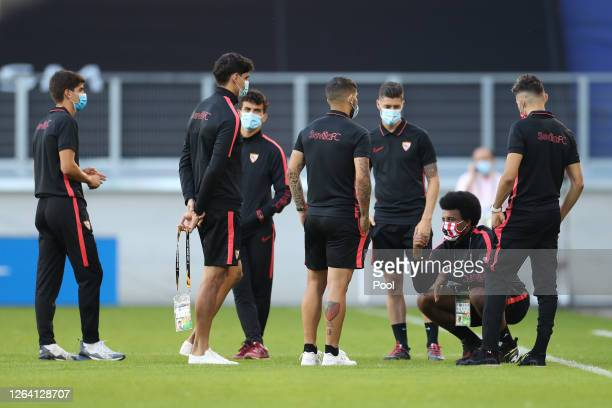 Sevilla players on the pitch wearing masks during a Sevilla Training Session And Press Conference at MSV Arena on August 05 2020 in Duisburg Germany