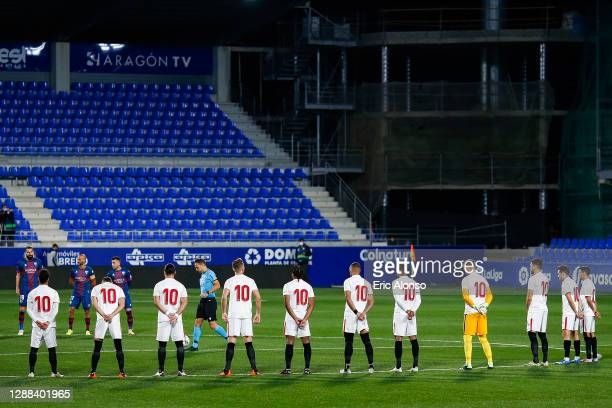 Sevilla players wear shirts with the number ten in memory of Diego Maradona prior to the La Liga Santander match between SD Huesca and Sevilla FC at...