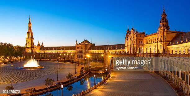 sevilla, plaza de espana at dusk - seville stock pictures, royalty-free photos & images