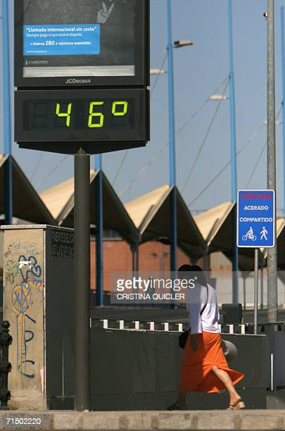A woman walks past a sign with a temperature reading in Seville 22 July 2006 Europeans were being urged to stay cool as a recordbreaking heatwave...