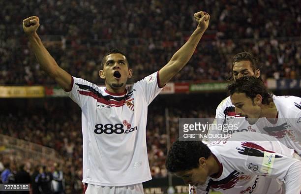 Sevilla's Brazilian Daniel Alves celebrates the winning goal by teammate Uruguayan Ernesto Javier Chevanton against Real Madrid during a Spanish...